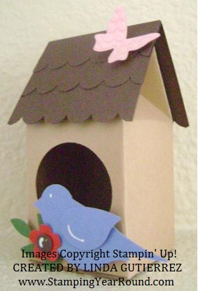 Milk carton bird house.